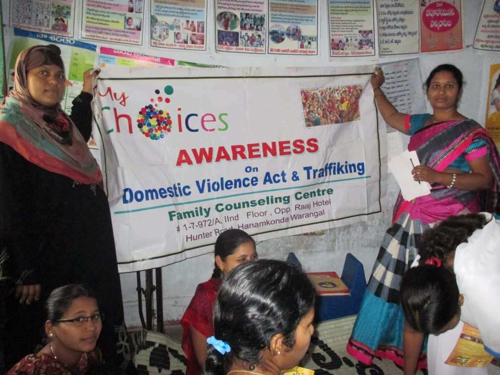 "Parveen Banu running a Basti Meeting. (Old ""My Choices"" used on the banner.)"